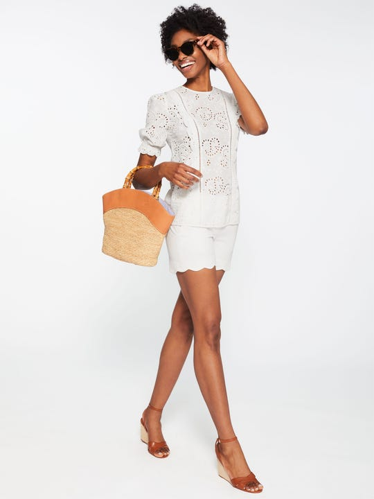 Model wearing J.McLaughlin Petal Shorts in White made with Cotton fabric.