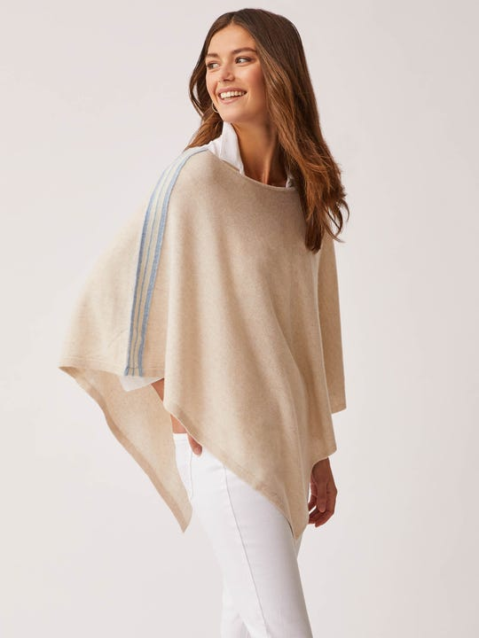 Model wearing J.McLaughlin Freya Cashmere Poncho in Stripe in heather oatmeal made with cashmere fabric.