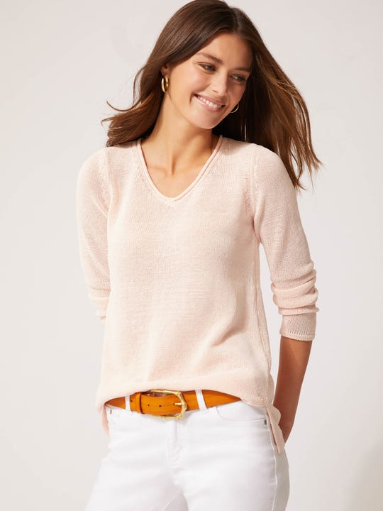 Model wearing J.McLaughlin Callum Sweater in pink made with Havana yarn fabric.