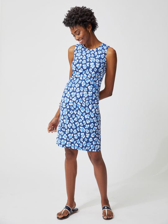 Model wearing J.McLaughlin Sophia Sleeveless Dress in Leo  in navy/blue/white made with Catalina cloth fabric.