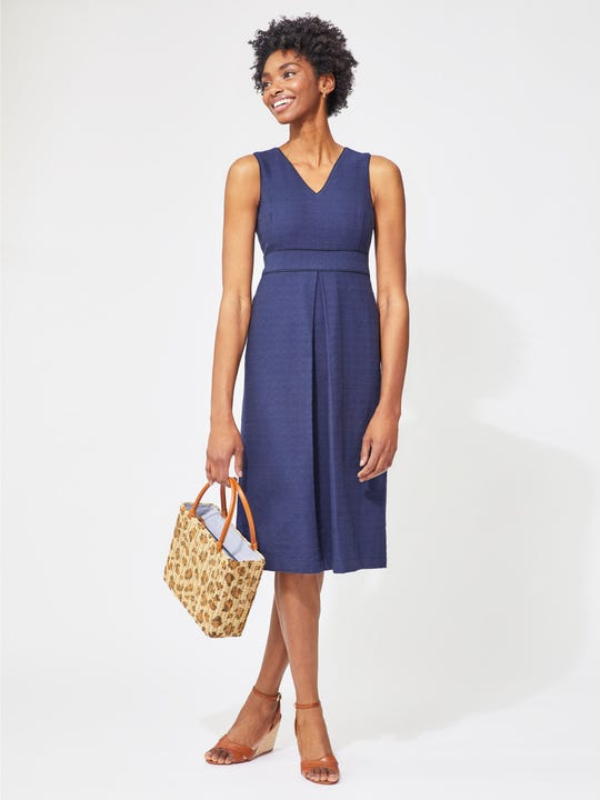 Model wearing J.McLaughlin Estrella Dress  in navy made with cotton and rayon fabric.