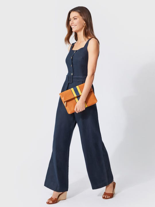 Model wearing J.McLaughlin Adalyn Jumpsuit  in navy made with linen fabric.