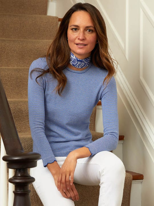 Model wearing J.McLaughlin Henri Sweater in Stripe  in blue/white made with Somerset cloth fabric.