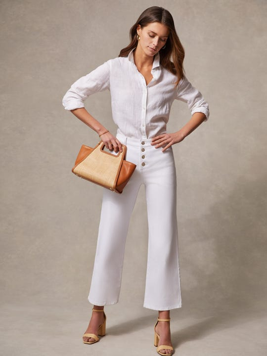 Model wearing J.McLaughlin Loris Jeans in white