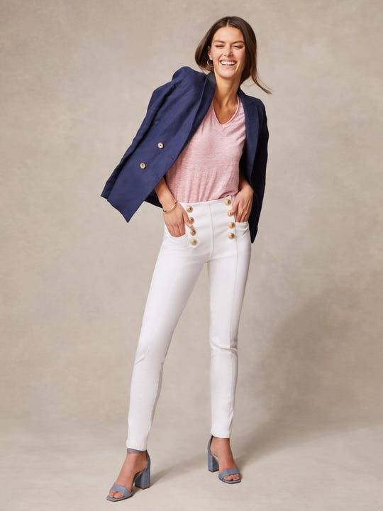 Model wearing J.McLaughlin Hastings Jeans in white made with denim fabric