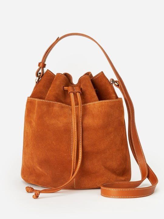 J.Mclaughlin Arianna Bucket Bag made with suede fabric and leather trim.