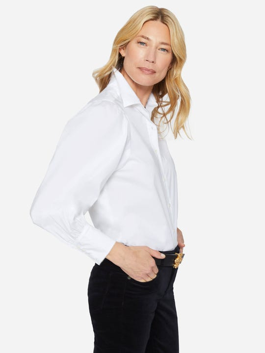 Model wearing J.McLaughlin Basil shirt in white made with cotton.
