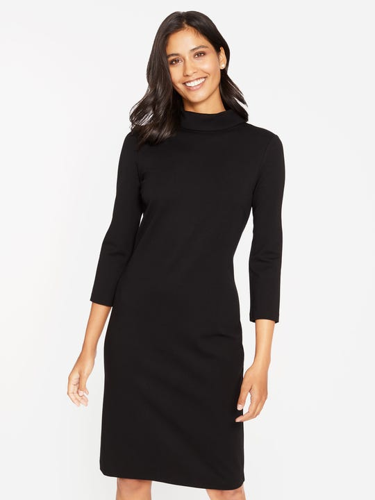 Model wearing J.McLaughlin Bertha Dress in black made with compact bainbridge.