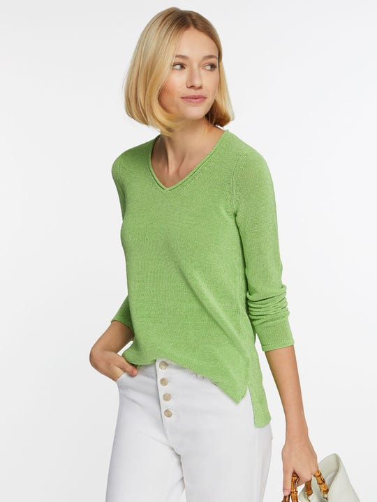 Model wearing J.McLaughlin Callum Sweater in green made with Havana yarn fabric.
