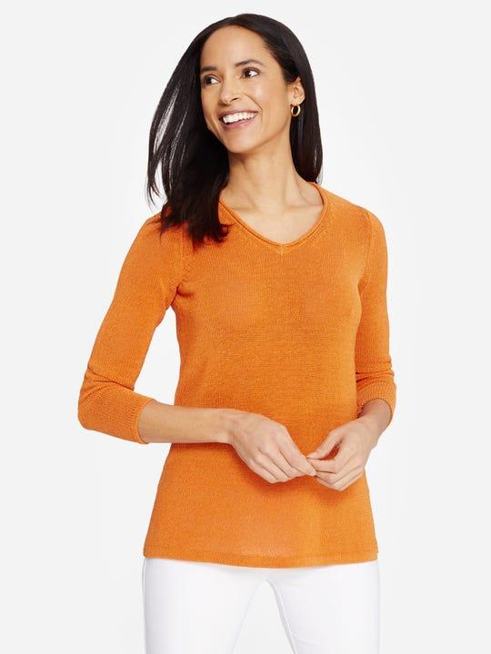 Model wearing J.McLaughlin Callum Sweater  in orange made with Havana yarn  fabric.