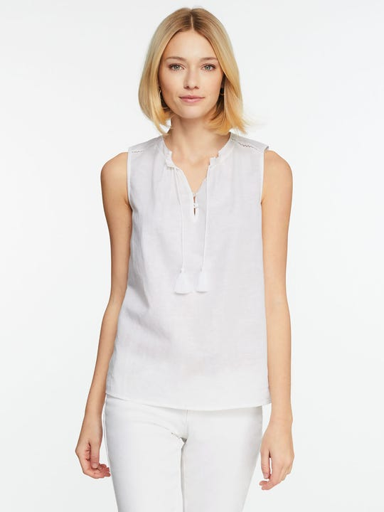 Model wearing J.McLaughlin Christa Blouse  in white made with cotton fabric.