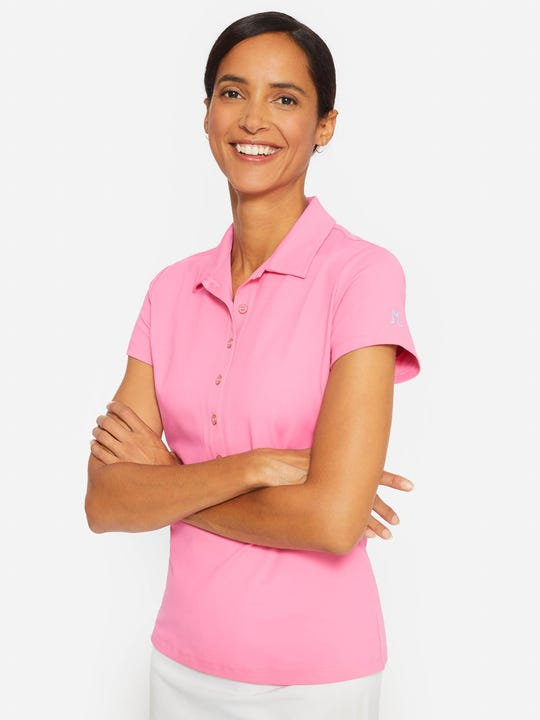 Model wearing J.McLaughlin Court polo in hot pink made with Catalina cloth.