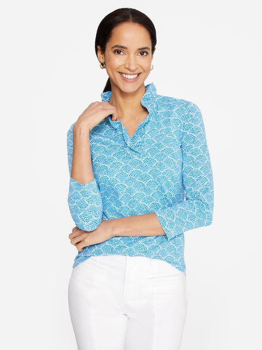 Model wearing J.McLaughlin Durham Ruffle Top in Fanned Blossom  in light blue/aqua/white made with Catalina cloth fabric.