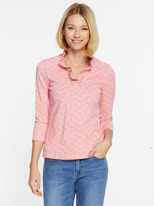 Model wearing J.McLaughlin Durham Ruffle Top in Fanned Blossom  in pink/orange/white made with Catalina cloth fabric.