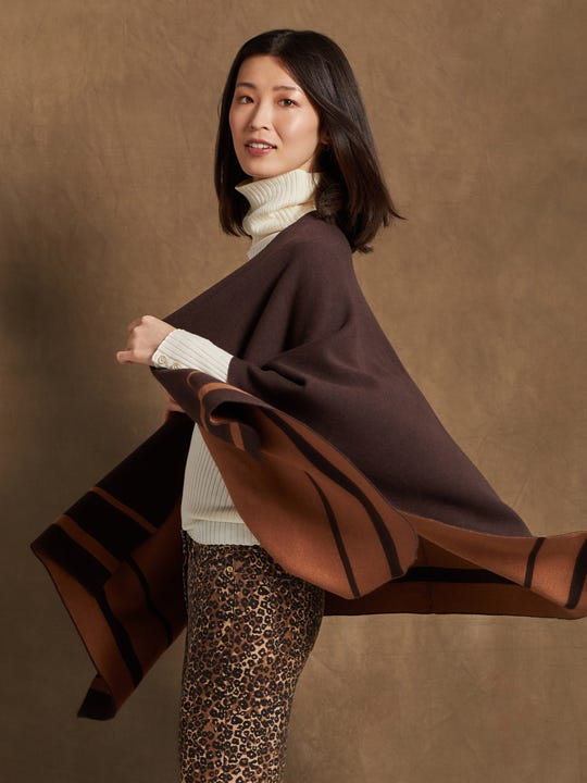 Model wearing J.McLaughlin Emberly Wrap in heather brown/light coffee made with cotton, modal, and nylon fabric.