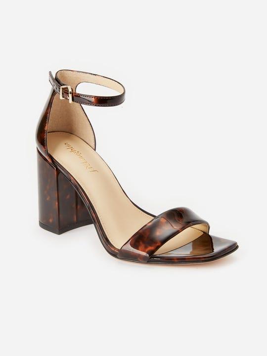 Model wearing J.McLaughlin Esme Sandals in brown/tortoise.