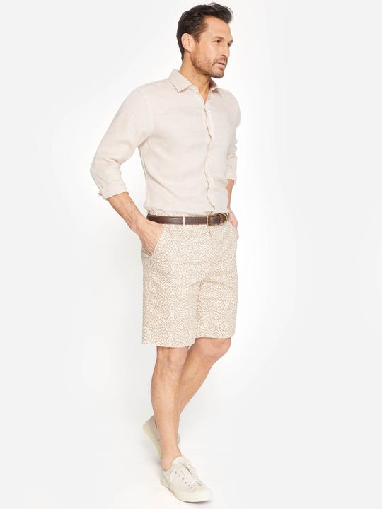 Model wearing J.McLaughlin Oliver Shorts in Mini Nile Geo  in tan/cream made with cotton fabric.