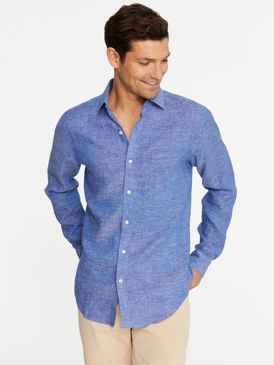 Model wearing J.McLaughlin Gramercy Classic Fit Linen Shirt in blue/white made with linen fabric.