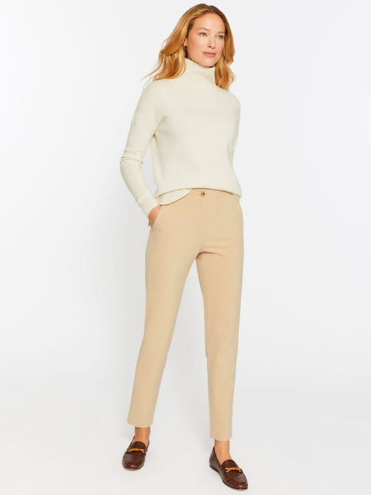 Model wearing J.McLaughlin Harvey pants in camel made with polyester.