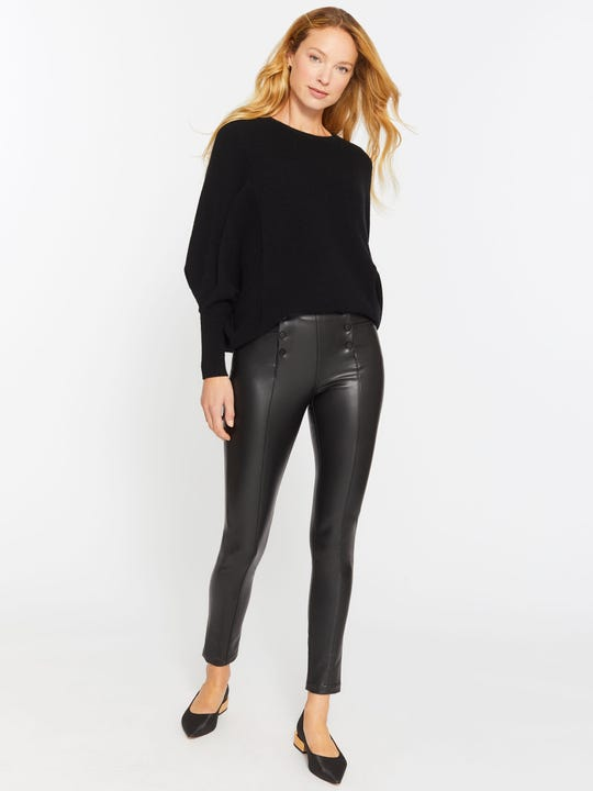 Model wearing J.McLaughlin Hastings pants in black made with faux leather.