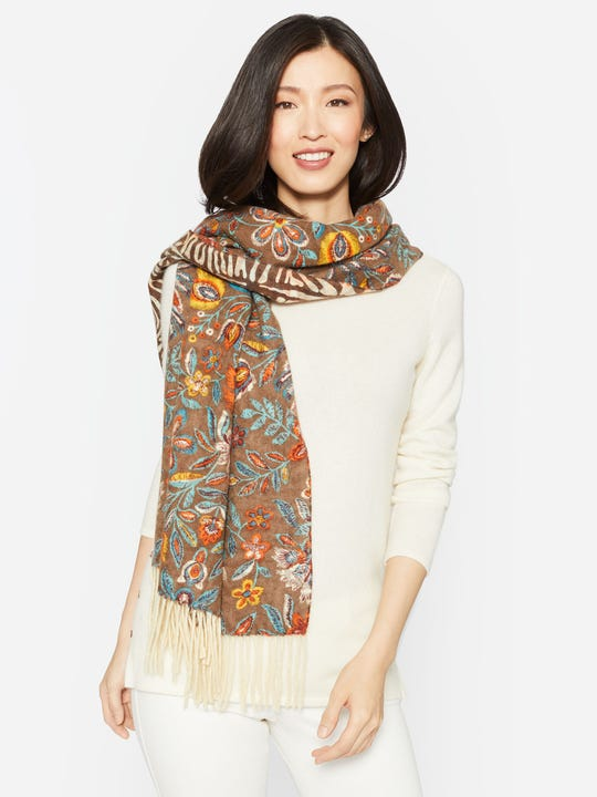 Model wearing J.McLaughlin Jaipur scarf in brown/multi made with cashmere.