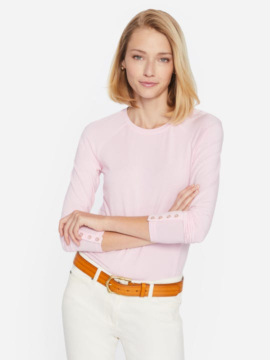 Model wearing J.McLaughlin Jana top in light pink made with modal and spndex fabric.