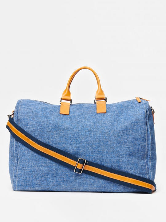 J.McLaughlin Joseph Duffle Bag in denim made with polyester fabric.