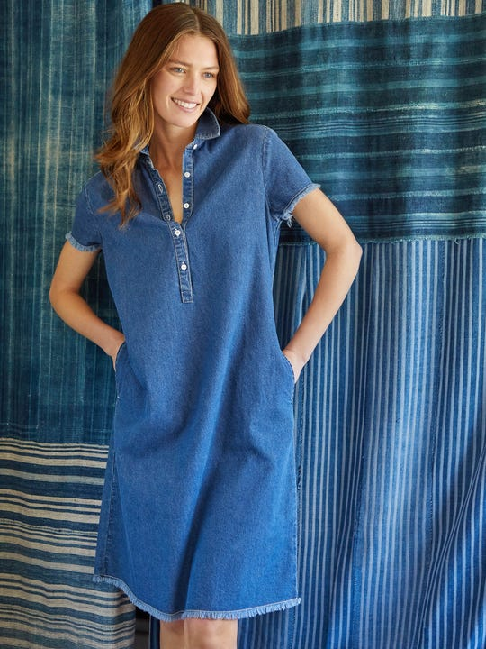 Model wearing J.McLaughlin Jones Dress in denim made with cotton fabric.