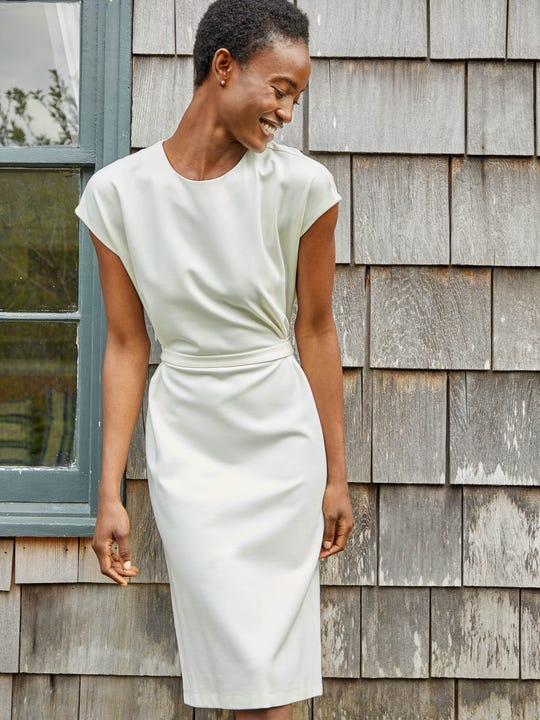 Model wearing J.McLaughlin Majorie Dress in Solid in ivory made with refined bainbridge fabric.