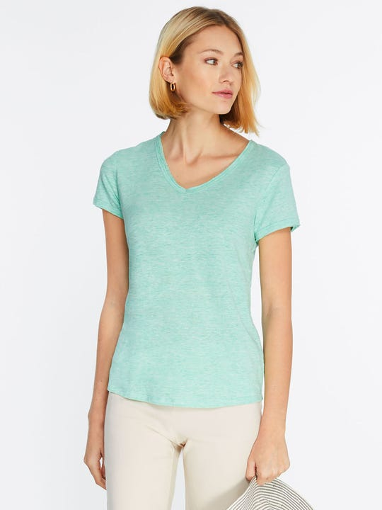 Model wearing J.McLaughlin Kacey Linen Tee  in green made with linen fabric.