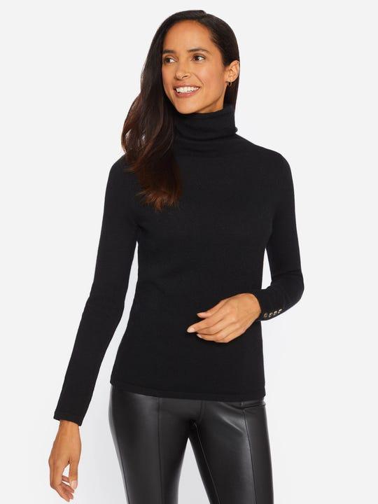 Model wearing J.McLaughlin Kitt turtleneck in black made with cashmere.