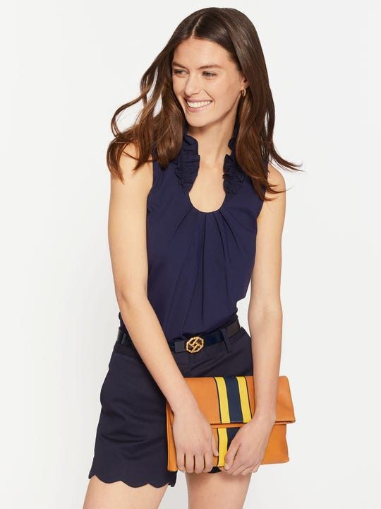 Model wearing J.McLaughlin Laurel Top in winter navy made with catalina fabric.