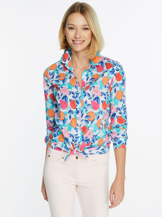 Model wearing J.McLaughlin Lois Shirt in Callery  in white/multi made with cotton fabric.