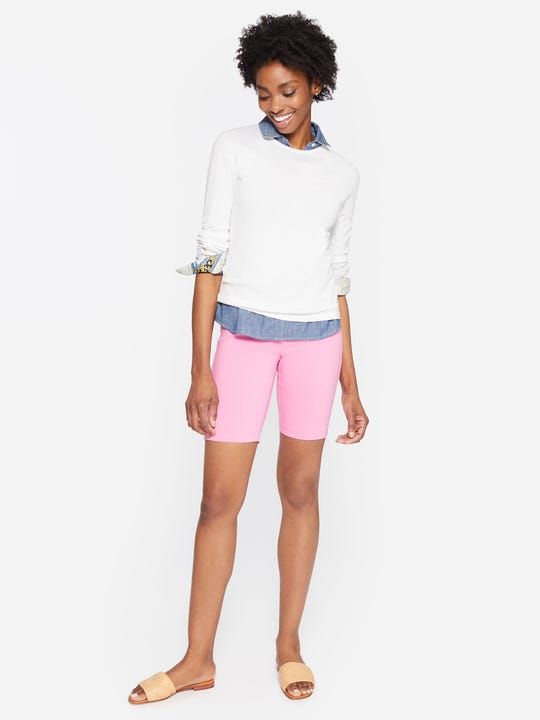 Model wearing J.McLaughlin Masie Shorts in begonia pink made with Amelia cloth fabric.