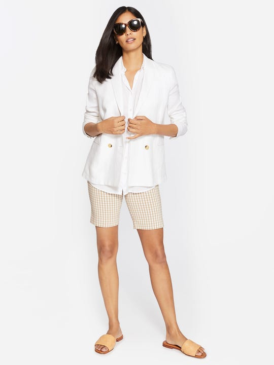 Model wearing J.McLaughlin Masie Shorts in Gingham in cuban sand/white made with Amelia cloth fabric.