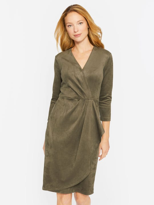 Model wearing J.McLaughlin Neville dress in olive made with faux suede.