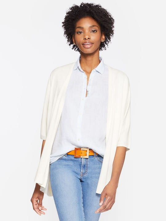 Model wearing J.McLaughlin Norah Cardigan in white made with cotton fabric.
