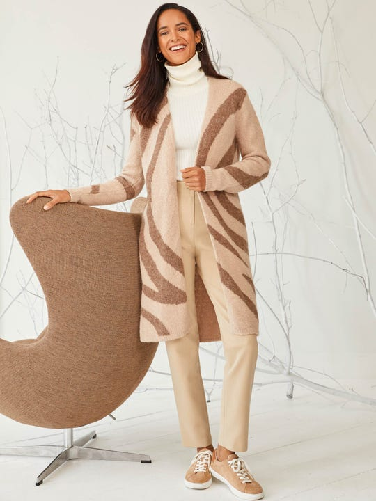 Model wearing J.McLaughlin Johanna sweater in taupe made with baby alpaca and merino wool.