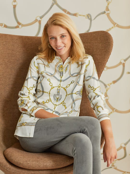 Model wearing J.McLaughlin Lois shirt in off white/gray/gold made with silk viscose.