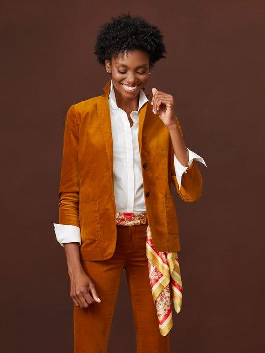 Model wearing J.McLaughlin Aubrey Blazer in mustard yellow made with velvet.