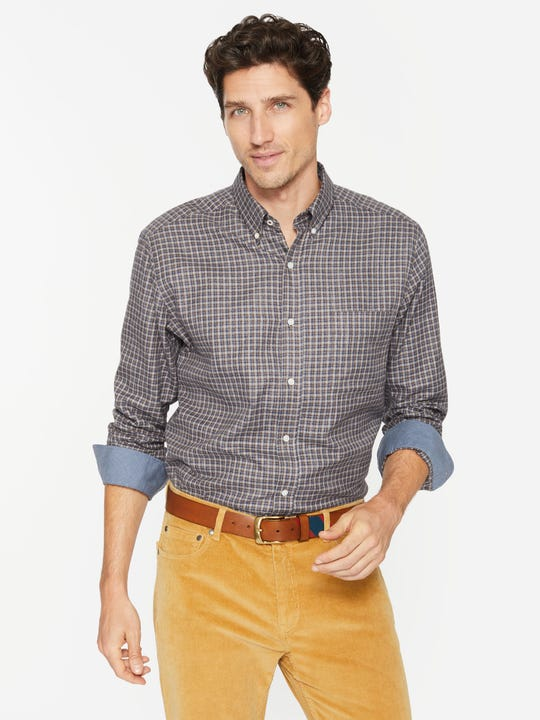 J.Mclaughlin model in carnegie shirt in brown/navy/tan made in cotton fabric.