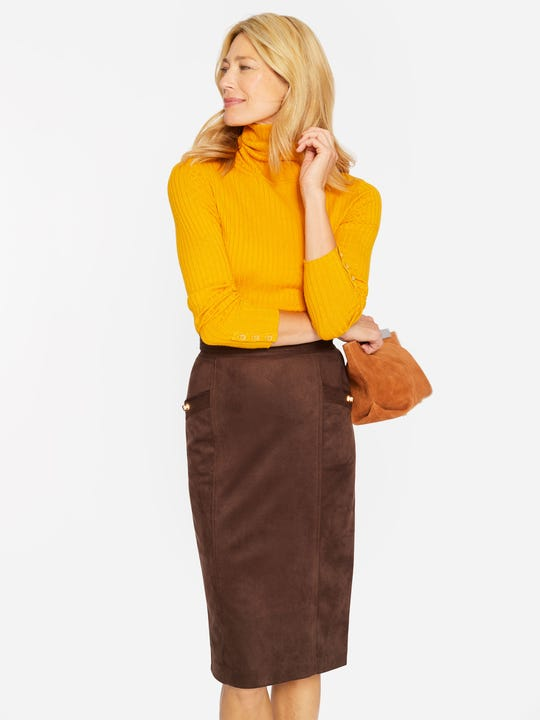 Model wearing J.McLaughlin Rowena Skirt in mocha made with faux suede.