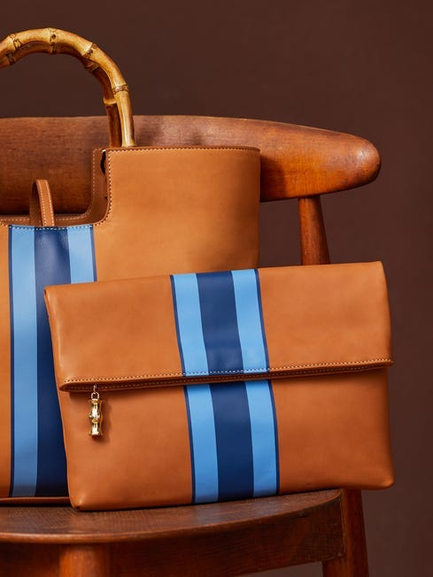 J.McLauglin Sienna clutch in natural/blue made with leather.
