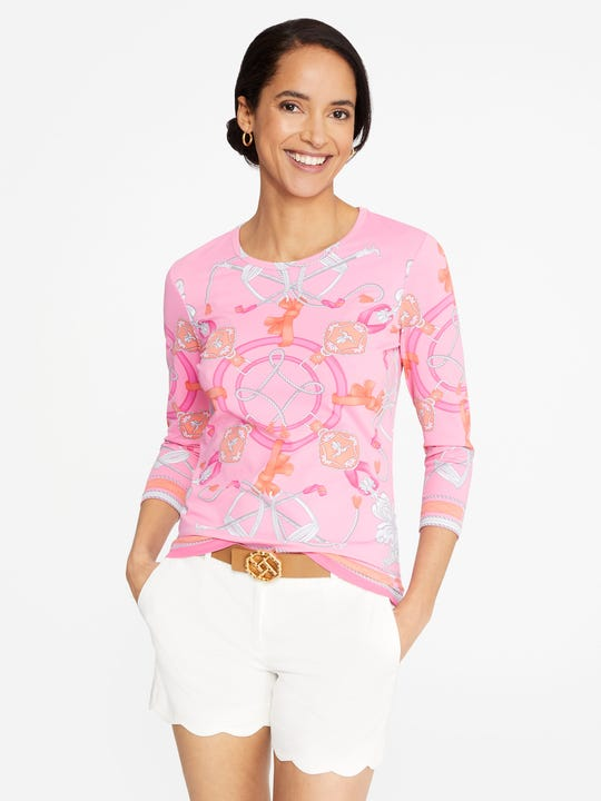 Model is wearing J.McLaughlin Signature Tee in Neo Sable Equestrian in pink/coral in Catalina cloth fabric.