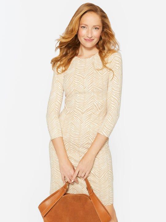 Model wearing J.McLaughlin Sophia Dress in Herringbone Pelage in tan/cream made with catalina fabric.