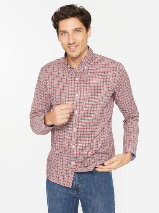 J.Mclaughlin model in carnegie shirt in white/red/brown made in cotton fabric.